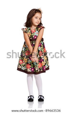 pretty little girl, wearing a beautiful colored dress, isolated on white background