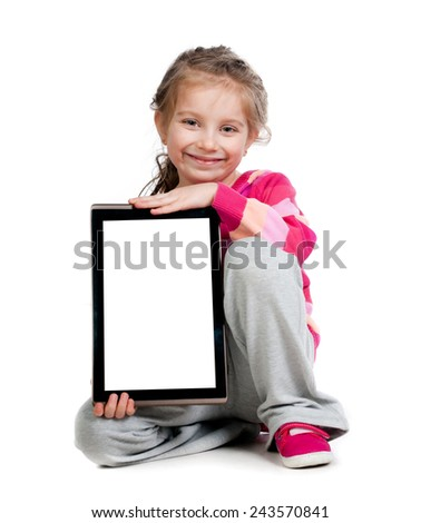 Pretty little girl with a Tablet PC - stock photo