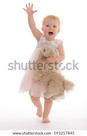 Pretty little girl with a toy dog - stock photo