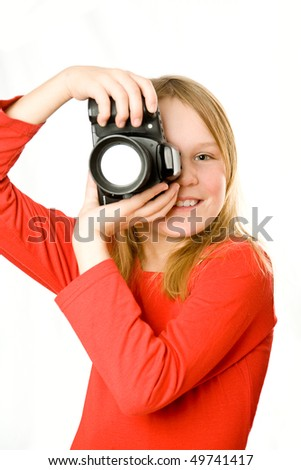 Pretty little girl with photo camera isolated - stock photo