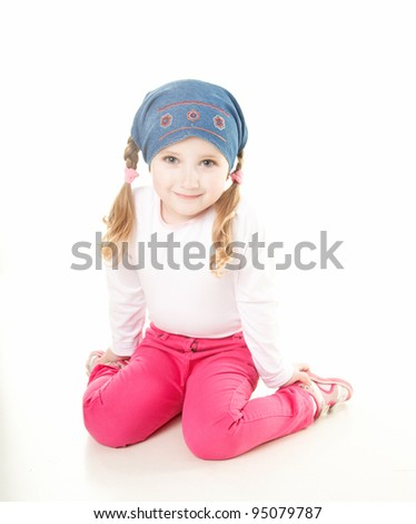 pretty little girl with pigtails - stock photo