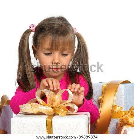 Pretty little girl with present - stock photo