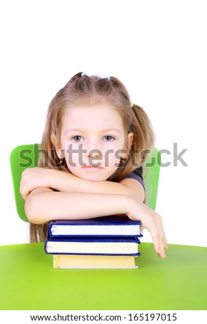 pretty little girl with the books - stock photo