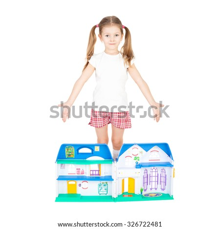 pretty little girl with the toy house - stock photo