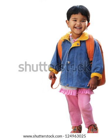 Pretty little indian pre-school girl ready to go to school in very cheerful and happy mood wearing colorful dress with a backpack. The photo is isolated on white. - stock photo