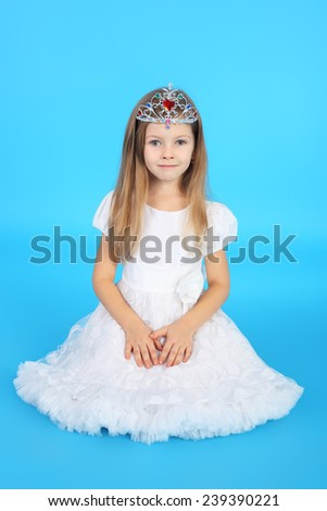 pretty little princess in the beautiful dress and diadem - stock photo