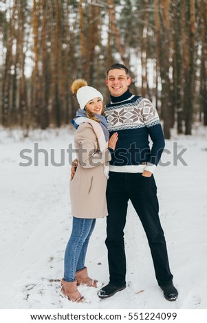 Pretty lovers in the winter forest