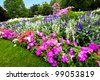 Pretty manicured flower garden with colorful azaleas. - stock photo