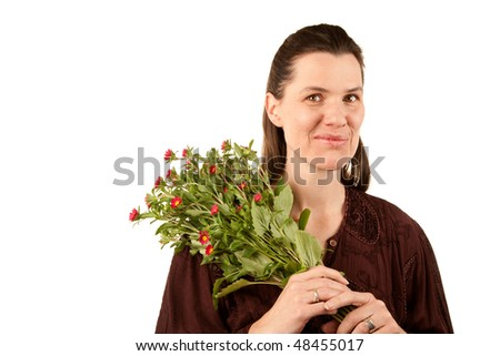 Pretty mature adult woman with bunch of wildflowers
