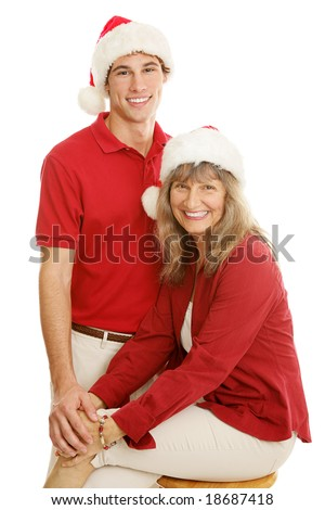 Pretty mature mother and young adult son posing for a Christmas portrait.  Isolated on white.