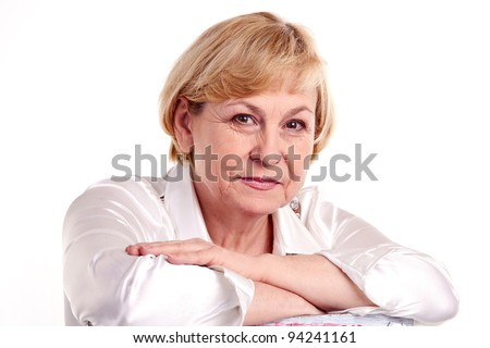 Pretty mature woman against white background - stock photo
