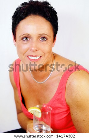 Pretty mature woman having a glass of water