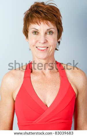 pretty, mature woman in good physical condition - stock photo