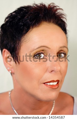 Pretty mature woman portrait with short black hair