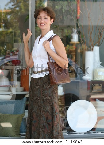 Pretty mature woman shopping in the city - stock photo