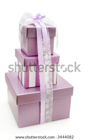 Pretty mauve gift boxes in a stack, tied with white and mauve ribbons.