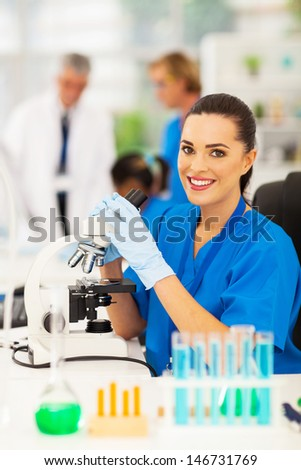 pretty medical lab technician working in lab - stock photo