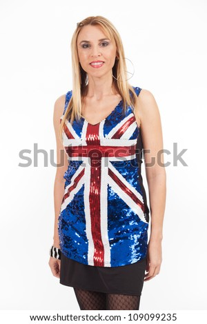 Pretty middle age woman wearing a sequin blouse with the British flag. - stock photo