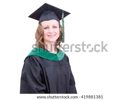 Pretty middle-aged academic in graduation clothing wearing a mortarboard cap and gown looking at the camera with a pleased happy smile, upper body on white with copy space