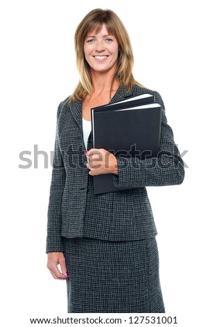 Pretty middle aged business lady holding important documents in files. - stock photo