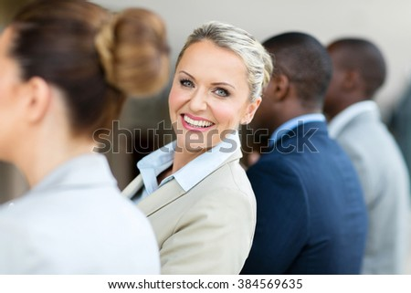 pretty middle aged businesswoman looking back  - stock photo