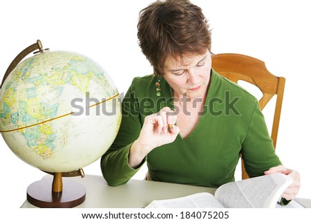 Pretty middle-aged woman studying in the library.  White background.