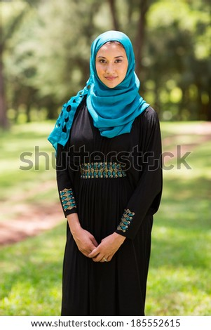 pretty middle eastern woman standing outdoors - stock photo