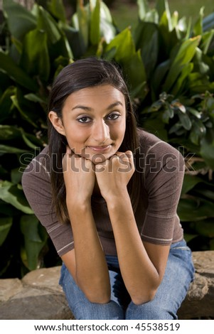 Pretty mixed-race Indian teen girl smiling at camera - stock photo