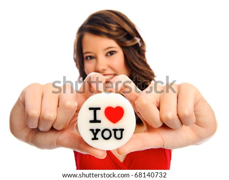 Pretty model holds a 'i love you' candle in studio, selective focus on message - stock photo