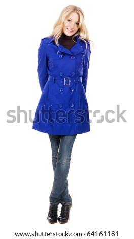 Pretty model in a blue coat against white background - stock photo