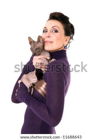 pretty model posing in studio with a cat - stock photo