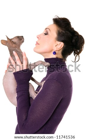 pretty model posing in studio with a cat - stock photo
