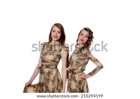 Pretty models posing in dresses from same cloth - stock photo