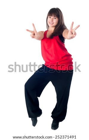 Pretty modern slim hip-hop style girl shows victory sign. Isolated over white