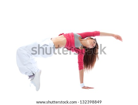 pretty modern slim hip-hop style teenage girl jumping dancing isolated on a white studio background - stock photo