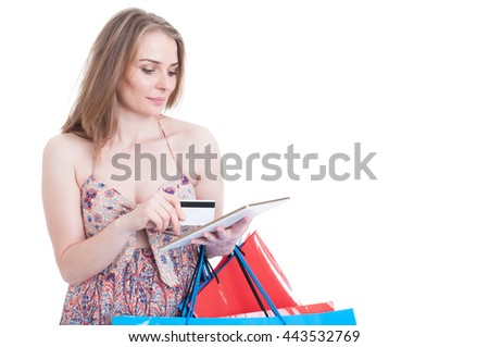 Pretty modern woman browsing on internet and paying with credit card as online shopping concept isolated on white with copyspace - stock photo