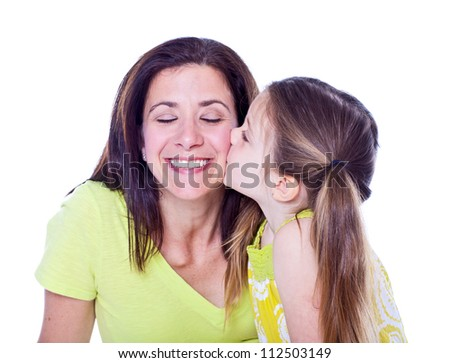 Pretty mother and daughter studio portrait on white - stock photo