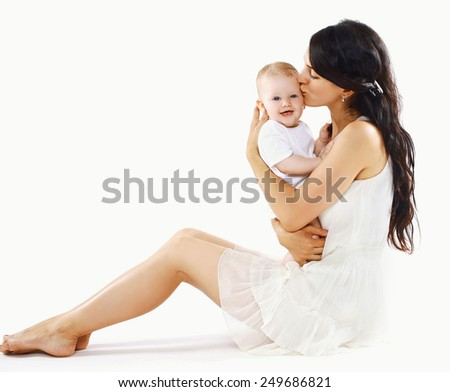 Pretty mother kissing happy baby - stock photo