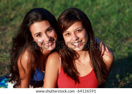 Pretty multicultural college teenagers and roommates enjoying university campus life. - stock photo