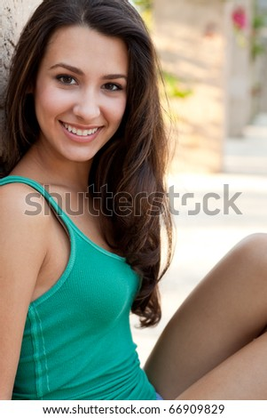 Pretty multicultural young woman in an outdoor lifestyle pose. - stock photo