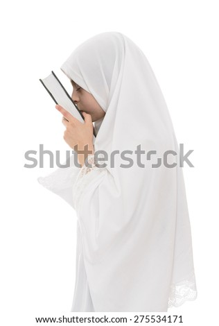 Pretty Muslim Girl in Love with Holy Book of Quran Isolated on White Background - stock photo