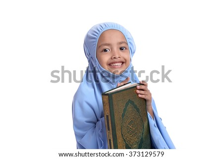 Pretty Muslim Hugging Loves Holy Book of Quran Isolated on White Background - stock photo