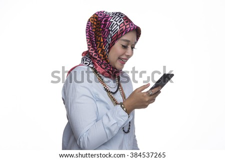 Pretty Muslim lady with mobile phone on a white background - stock photo
