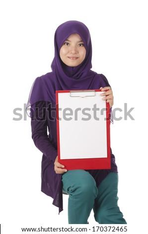 Pretty muslim woman model holding a board - stock photo