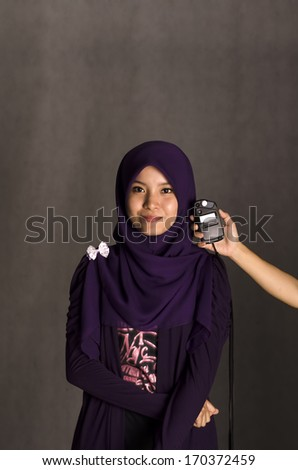 Pretty muslim woman model in action - stock photo