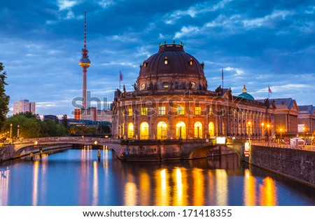 Pretty night time illuminations of the Bode Museum (1904) which is part of the complex of museums that make up 'Museum Island' in Berlin, Germany. - stock photo