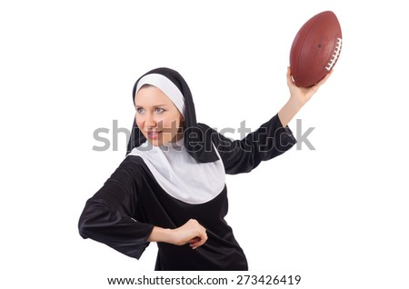 Pretty nun with rugby ball isolated on white - stock photo