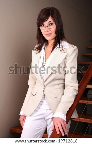 Pretty office worker standing on a staircase