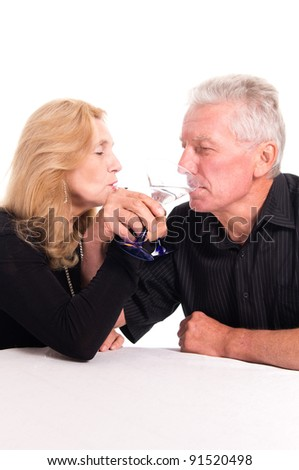 pretty old couple sitting at table on white