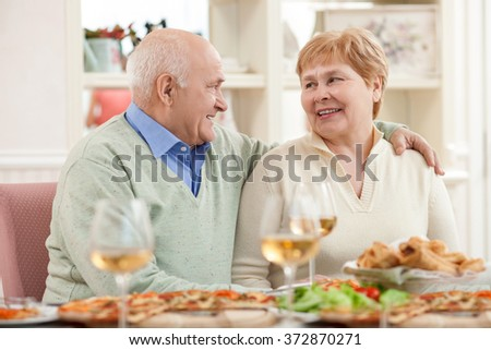 Pretty old husband and wife have a lunch - stock photo
